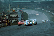 With Ickx down the road Pedro Rodriguez powers past Stommelen into Paddock Hill.