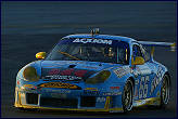 Kevin Buckler speeds through the dawn in his Racers Group Porsche on the way to victory in the 2003 Rolex 24